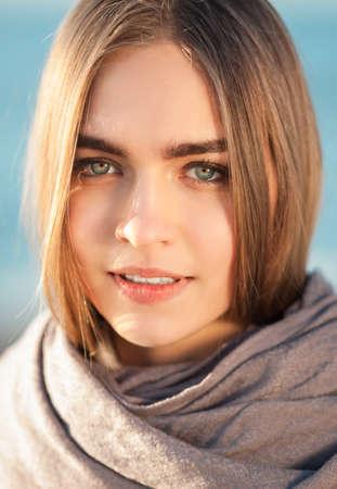 outdoor shot: Beautiful girl is smiling. Outdoor shot
