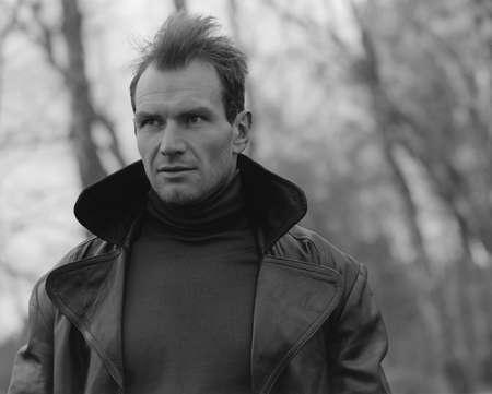 trench coat: Pensive guy portrait. Trench coat. Outdoor shoot
