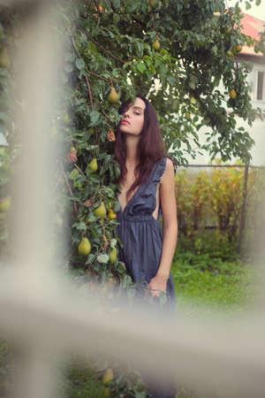 intrigue: Sensual girl portrait at yard. Outdoor shot