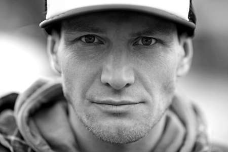 trucker: Portrait of serious man, trucker cap Stock Photo