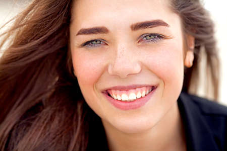 Beautiful young girl is smiling