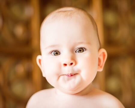 making a face: Closeup portrait of a cute little baby making a face Stock Photo