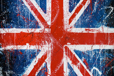 Painted concrete wall with graffiti of British flag. Grunge flag of United Kingdom. Union Jack Imagens