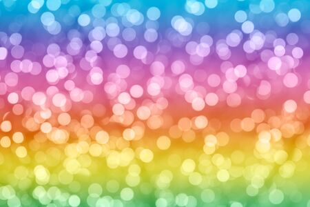Rainbow colorful background with natural bokeh defocused sparkling lights. Bright and vivid texture with twinkling lights Фото со стока