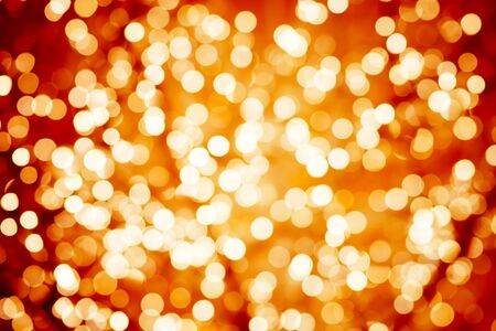 Flame-coloured background with natural bokeh defocused sparkling lights. Colorful fiery texture with twinkling lights. Bright and vivid colors Фото со стока
