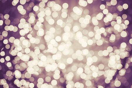 Colorful background with natural bokeh defocused sparkling lights. Vintage texture with twinkling lights. Instagram filters. Retro colors Фото со стока