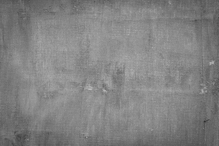 Cracked dark grey concrete wall with net holes splits and stains. Texture cement background