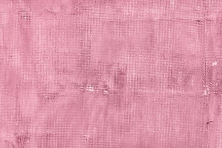 Old cracked concrete wall with net holes splits and stains. Texture cement background. Pink rosecolored and rosy colors