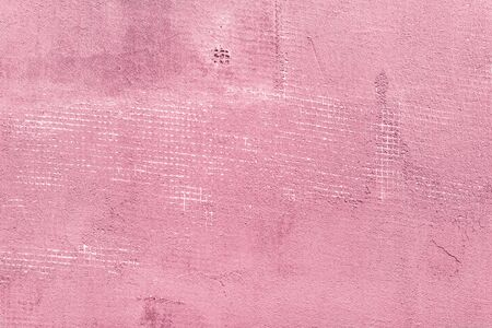 I splitted and cracked concrete wall with net and holes textured cement background. Pink and rosy vintage colors