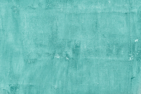 Old cracked concrete wall with net holes splits and stains. Texture cement background. Turquoise motton blue mint and tiffani colors photo