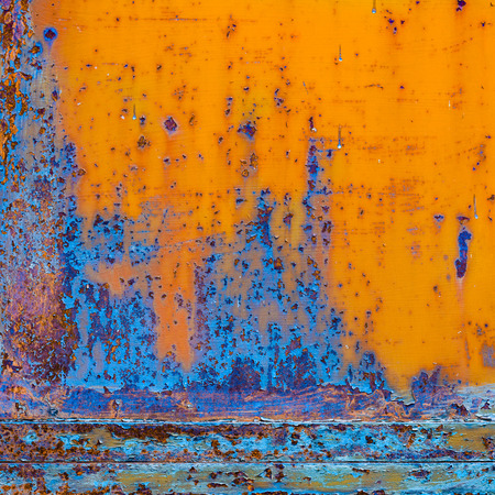 Rusty painted metal with cracked paint. Orange and blue colors. Texture color grunge background Stok Fotoğraf