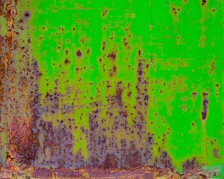 Rusty painted metal with cracked paint. Orange brown and green colors. Texture color grunge background Фото со стока