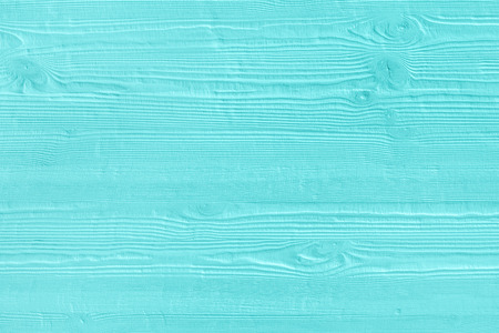 Natural wooden turquoise boards, wall or fence with knots. Abstract textured mint background, empty template