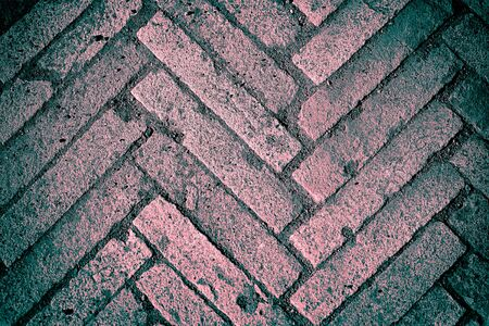 Old block pavement, fragment, texture background, pink and turquoise colors