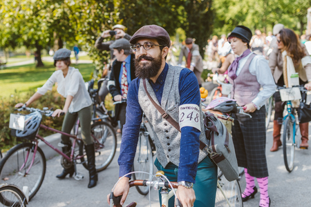 Toronto, Canada - September 20, 2014: Unidentified participants of Tweed Ride Toronto riding on their bicycles. This annual event also known as Tweed Run is dedicated to the style of old England: people dress up in vintage style clothes and try to reconst Фото со стока - 40957788