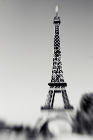 Blurred shot of the Eiffel Tower in Paris France selective focus on details. Lensbaby photo of Eiffel Tower black and white colors Фото со стока
