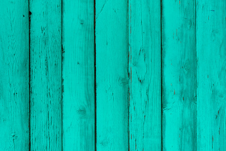 Natural wooden mint boards, wall or fence with knots. Painted turquoise wooden vertical planks. Abstract textured background, empty template