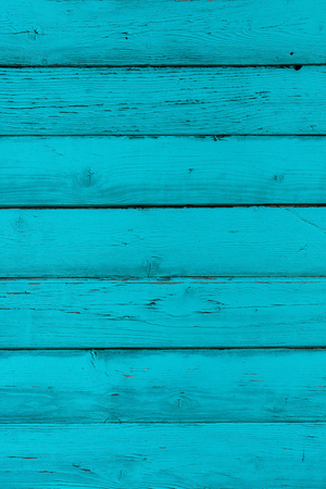 Natural wooden blue, turquoise boards, wall or fence with knots. Painted wooden vertical planks. Abstract textured background, empty template