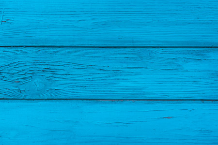 Natural wooden blue boards, wall or fence with knots. Painted wooden horizontal planks. Abstract textured background, empty template Фото со стока