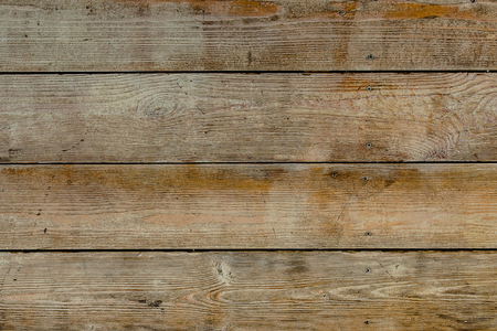 Natural wooden brown and rusty boards, wall or fence with knots and nails. Abstract texture background, empty template