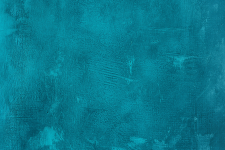 Old scratched and chapped painted blue wall. Abstract textured turquoise background, empty template Stockfoto