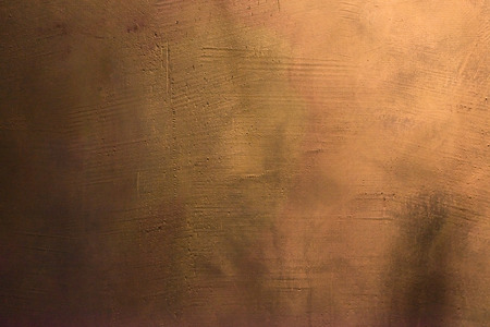 Old scratched and chapped painted gold and orange wall. Abstract textured colored background, empty template Stock Photo
