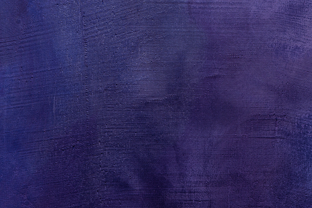 Old scratched and chapped painted violet and purple wall. Abstract textured colored background, empty template Banque d'images