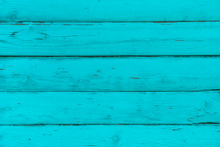 Natural wooden blue, turquoise boards, wall or fence with knots. Abstract textured background, empty template. Horizontal planks of wood, mint color