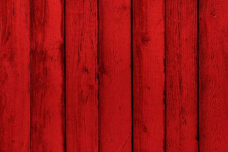 Natural wooden painted red boards, wall or fence with knots. Abstract textured background, empty template. Painted wooden vertical planks Фото со стока