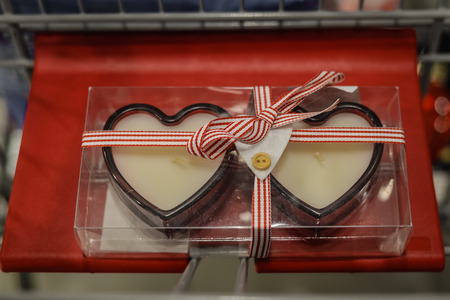 chandler: Two Valentines red heart candles in a decorating store interior background Stock Photo