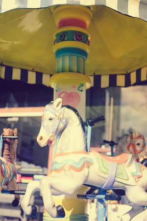 merry time: Merry Go Round horse at festive carousel carnival. Joyful time concept Stock Photo