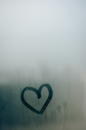 tarnished: Love heart painted on glass. The window is fogged up with drops on the background