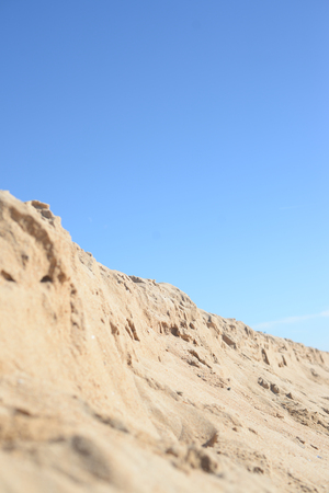 bleaching: Hot and dusty landscape bleaching in the hot sun with mountain over blue sky background Stock Photo