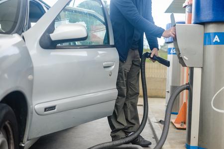 domestic garage: Person using self service automatic car wash vacuum machine. Auto cleaning concept.
