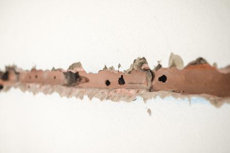 refurbishment: Groove in the cement brick, building refurbishment process