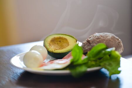avacado: Avacado, bread, bacon and egg with salad in plate on table, closeup