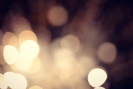 festive background: Flickering golden defocused light. Abstract festive background Stock Photo
