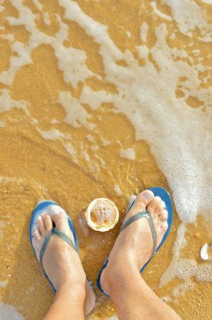 flops: Beach outdoors background - feet in flip flops. Summer vacation idea