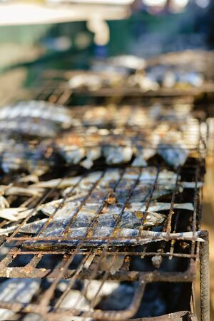 coal fish: Closeup on fish in a grill, top view