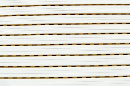 iron curtains: White roller shutter background surface Stock Photo