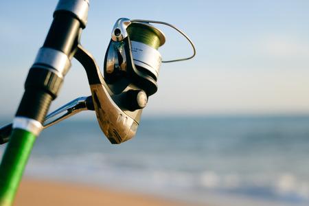 fishingline: Closeup on fisherman rod on the ocean coast background