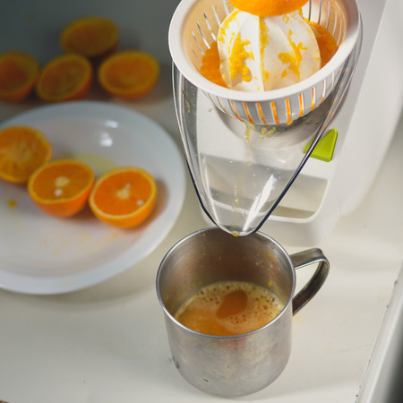 juice squeezer: Orange juice maker squeezer closeup Stock Photo