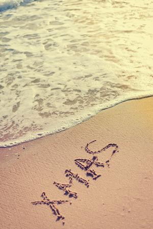 xmas background: Xmas word sign on tropical beach background Stock Photo