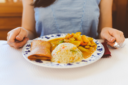 eating lunch: Closeup on chicken curry, rice and spring roll served table background Stock Photo