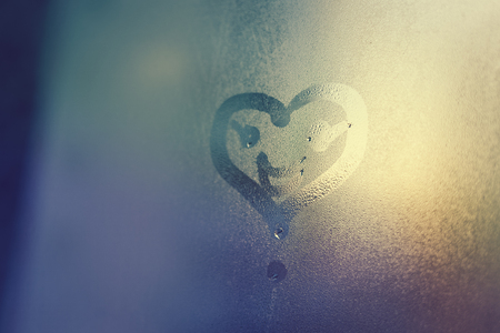 highway love: Smile face and heart drawing on window, season abstract background. Rain drops Stock Photo