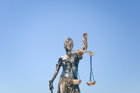 Sculpture of justice or themis goddess on bright blue sky background outdoors Stock Photo