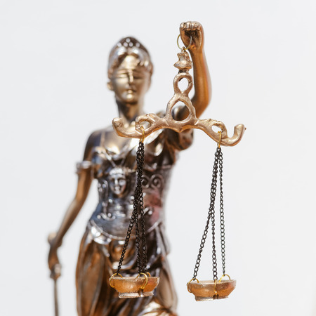 Sculpture of justice, femida or themis goddess on light copy space background Stock Photo