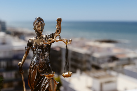 judicature: Sculpture of justice or themis goddess on bright blue sky background outdoors Stock Photo