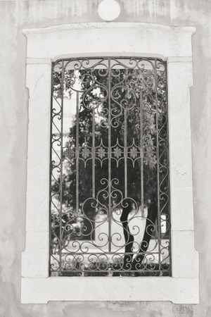 iron barred: Closeup view of window with beautiful decorative protective lattice Stock Photo