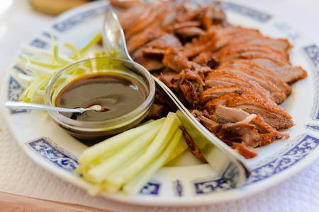 hoisin sauce: Peking duck on light table background, closeup top side view
